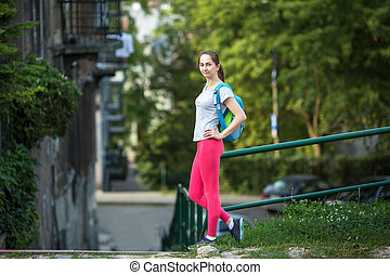 sporty woman standing outdoors