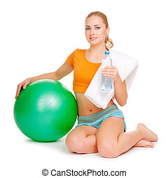 Young sporty woman with ball