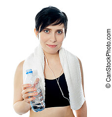 Young sporty woman with towel isolated