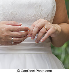 young spouses play with love rings that they have given themselves