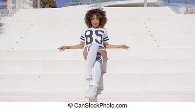 Young srylish girl on stairs - Young stylish female in...