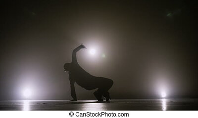Young street dancer boy dancing on a talent show competition stage to become popular