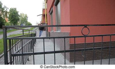 Young street man doing parkour exercise with stairs