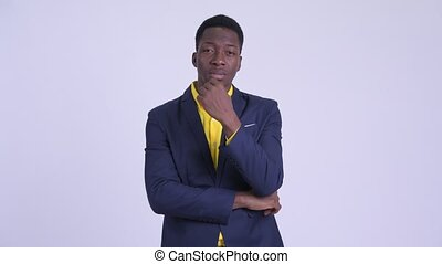 Young stressed African businessman getting bad news - Studio...