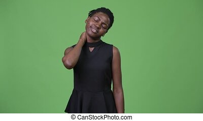 Young stressed African businesswoman having neck pain