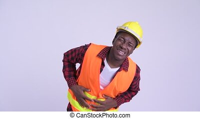 Young stressed African man construction worker having...