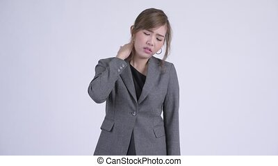 Young stressed Asian businesswoman having neck pain