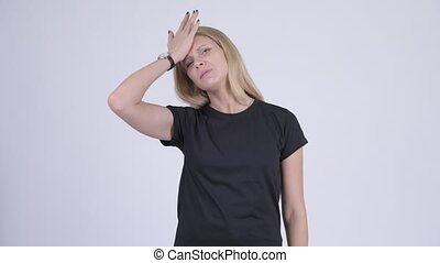 Young stressed blonde woman getting bad news - Studio shot...