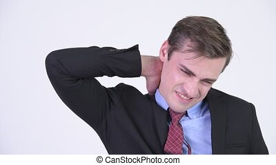 Young stressed businessman having neck pain