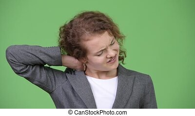 Young stressed businesswoman having neck pain - Studio shot...
