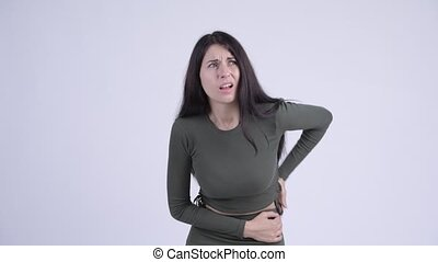 Young stressed woman having stomach ache