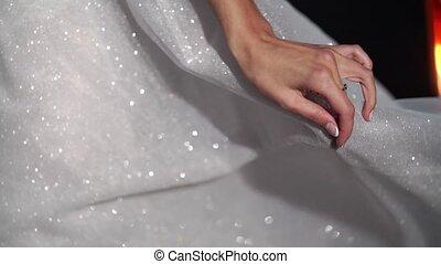 Young strong beautiful bride waving her white wedding dress...