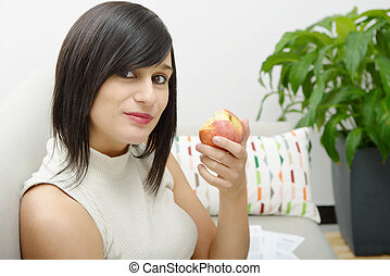 young student eating an apple