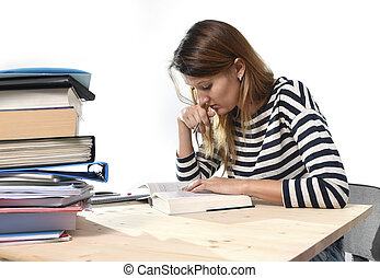 young student girl concentrated studying for exam at college library education concept