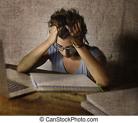 young student girl studying late night  tired at home laptop computer preparing exam exhausted