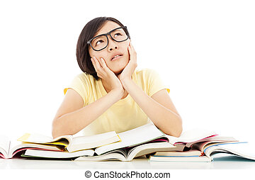 young student girl thinking with book on the desk