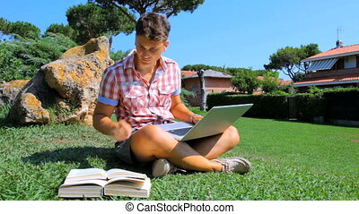 Young student reading in park