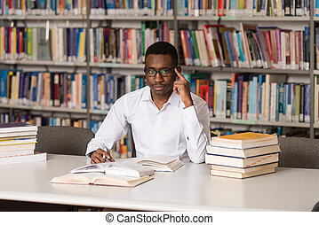 Young Student Sitting At The Library