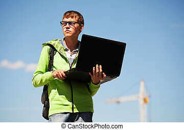 Young student using laptop