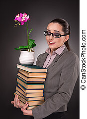 Young student with books and clock