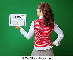 young student woman looking at Certificate of Graduation
