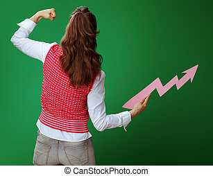 young student woman with rising graphics arrow showing biceps