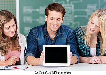 Young students displaying a blank tablet-pc