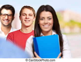young students group smiling over abstract background