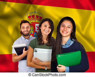 Young students over spanish flag