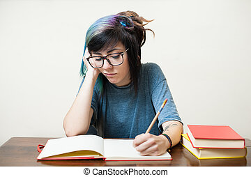 Young studying female student with books