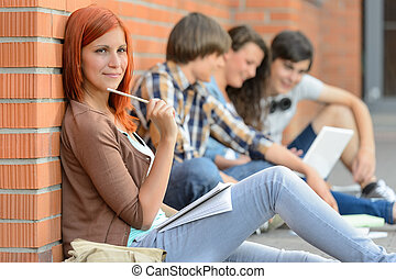 Young studying woman friends sitting in background