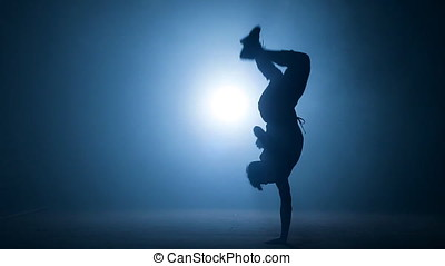 Young stuntman performing the trick in the air. - Young...