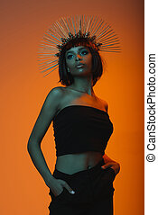 young stylish african american woman in headpiece with...