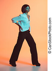 young stylish african american woman posing at studio