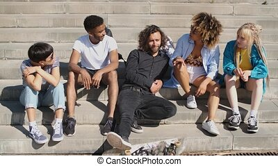 Young stylish friends on street steps - Cool modern...