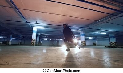 Young stylish man freerunner doing a series of jumps,...