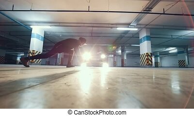 Young stylish man freerunner performing a handstand, parkour...