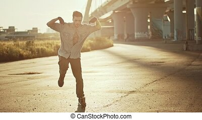Young stylish man performing freestyle dancing. Mid shot
