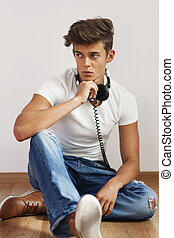 Young stylish man relaxing on the wood floor