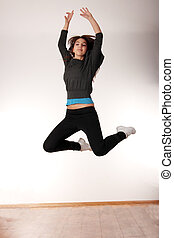 Young stylish woman dancing modern dance