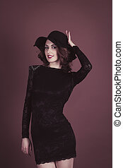 Young stylish woman in hat