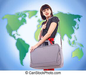 young stylish woman traveling on world map background