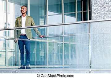young successful african business man outdoor in summer