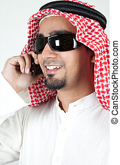 Young successful arab talking over cell phone and smiling