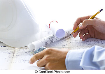 architect - young successful architect at work with his plan