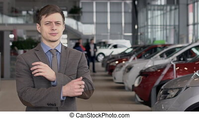 Young successful businessman is posing standing in car...
