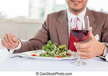 Young successful businessman is resting in restaurant