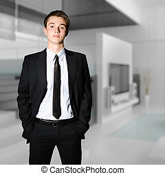 young successful businessman standing in a modern office