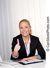 young successful woman in an office