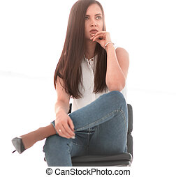 young successful woman sitting in a chair